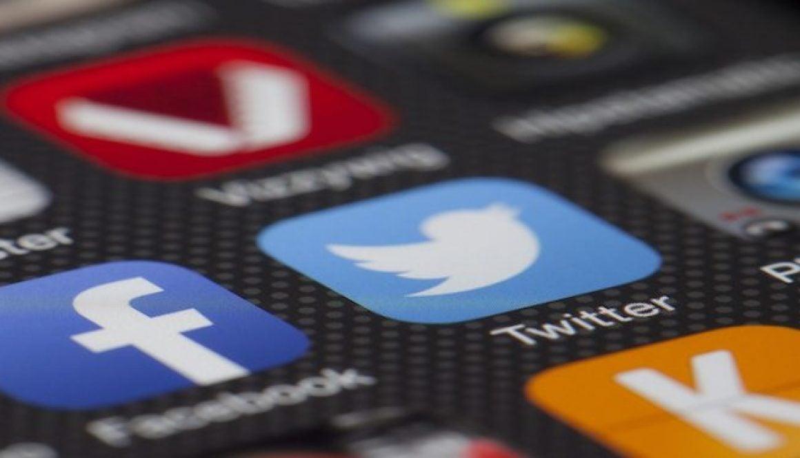 Canva - Iphone Displaying Social Media Application